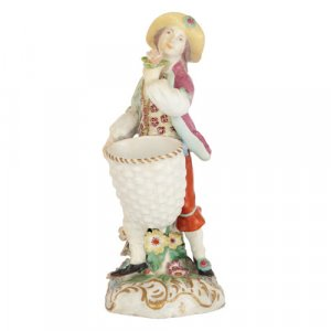 Antique Chelsea porcelain figure of a vintager