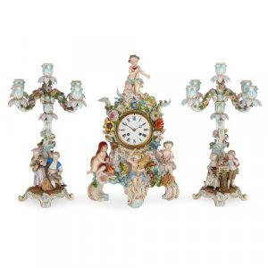 Antique Meissen porcelain clock and candelabra garniture set