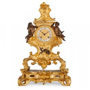 French Louis XV style gilt and patinated bronze mantel clock