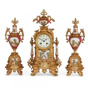 Sèvres style porcelain and gilt metal three-piece clock set