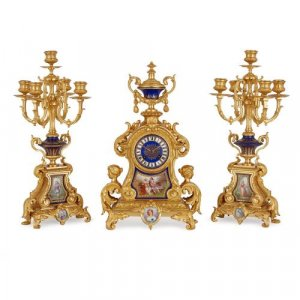Sèvres style porcelain mounted ormolu three piece clock set