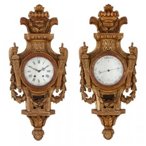 Louis XVI style carved giltwood cartel clock and barometer set