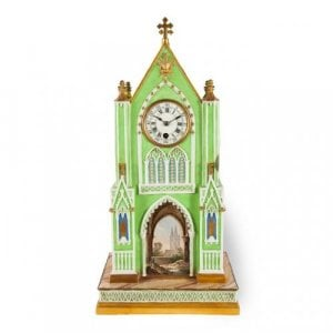 A Gothic revival Dagoty & Honore porcelain cathedral form mantel clock