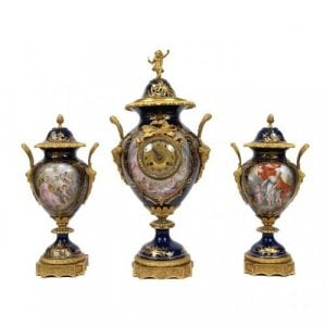 An ormolu mounted Sevres porcelain three piece clock set