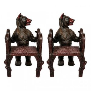 A pair of Black Forest carved wood miniature children's armchairs