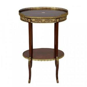 A Transitional style ormolu mounted mahogany oval shaped two tiered table