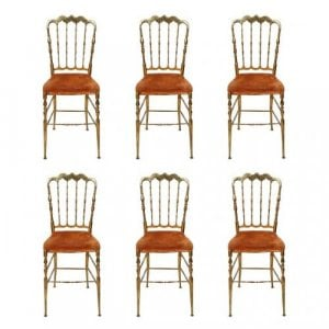 A set of six brass spindle back Chiavari dining chairs