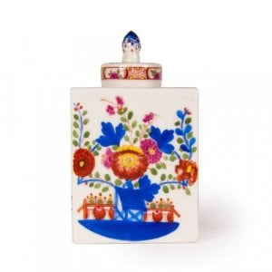 A miniature porcelain tea caddy