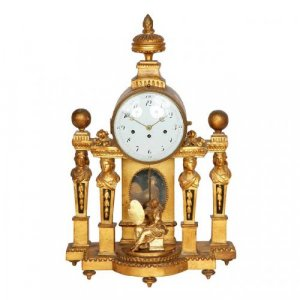 A Neoclassical giltwood mantel clock