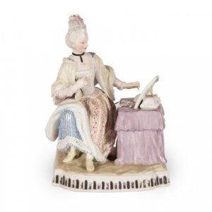 A Meissen porcelain figural group emblematic of the visual sense