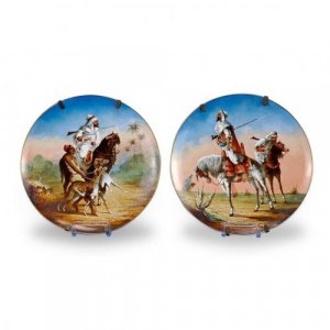 A pair of Orientalist porcelain plates of Arab horsemen