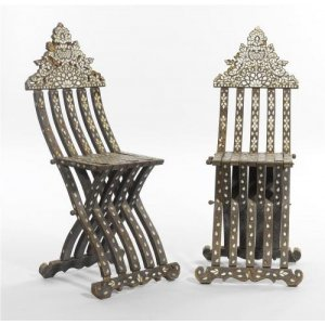 A pair of Orientalist folding chairs