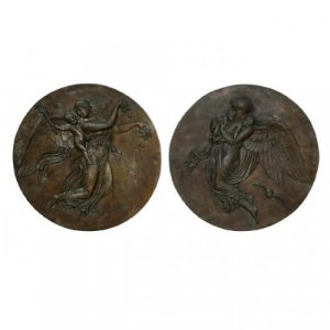 A large and impressive pair of circular patinated bronze relief plaques of Night and Day