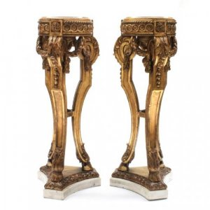 A pair of Louis XVI style marble and carved giltwood tripod pedestals