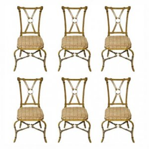 An unusual set of six wrought iron chairs of modern design