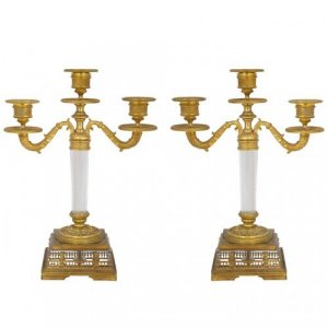 A fine pair of Empire period ormolu and crystal three light candelabra
