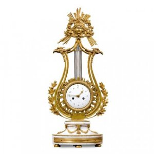A Louis XVI period white marble and ormolu lyre shaped mantel clock