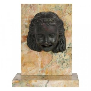 A patinated bronze and marble fountain element