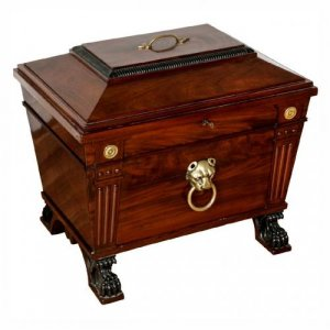 A George IV style brass mounted mahogany wine cooler