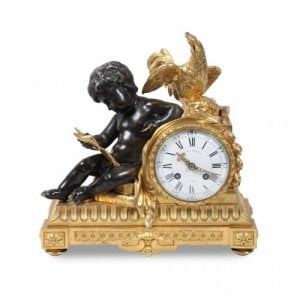 A gilt and patinated bronze mantel clock by Henry Dasson