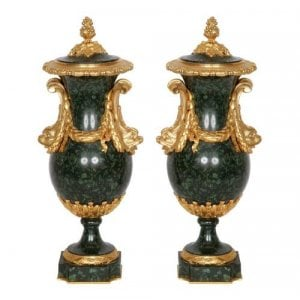 A pair of ormolu mounted green porphyry vases