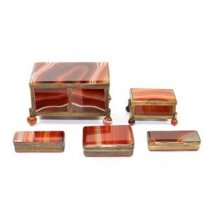 A collection of five gilt metal mounted agate boxes