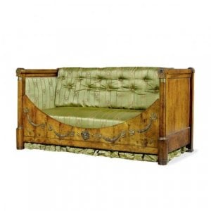 A Restauration period ormolu mounted mahogany daybed