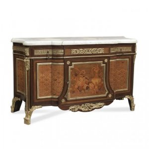 A fine and large Louis XVI style ormolu mounted marquetry commode