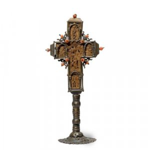 A coral mounted silver and carved wood cross