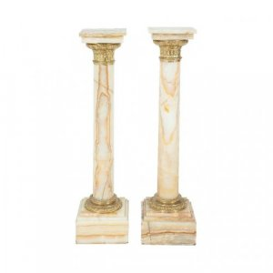 A pair of ormolu mounted onyx pedestals