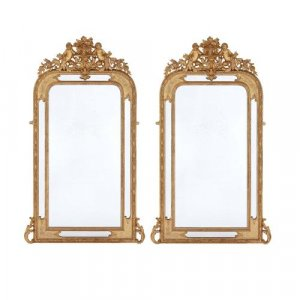 Pair of French antique carved giltwood mirrors with cherubs