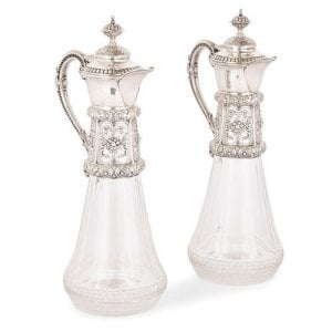 Pair of antique German silver mounted cut glass jugs