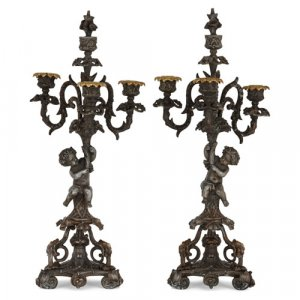 Pair of Napoleon III period patinated metal candelabra