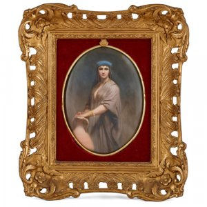 Oval KPM porcelain plaque depicting a lady with a pitcher