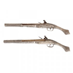 Pair of Balkan silver and gold-damascened flintlock pistols