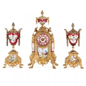 Antique gilt metal and painted porcelain red clock set