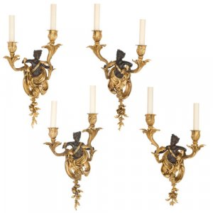Four Louis XV style gilt and patinated bronze wall lights