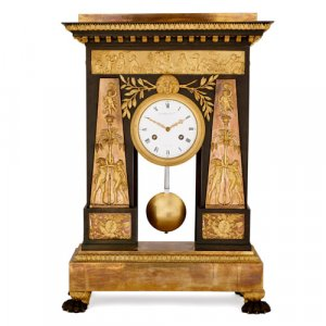Empire period gilt and patinated bronze clock by Deverberie