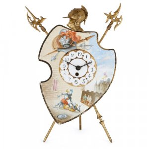 Antique porcelain and ormolu shield shaped mantel clock