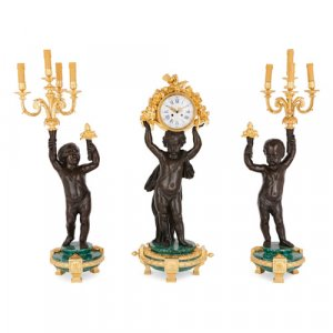 Large ormolu, malachite and patinated bronze clock set