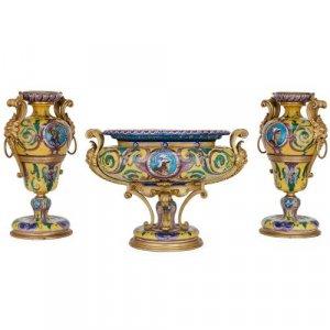 Three piece porcelain centrepiece garniture by Henry Dasson
