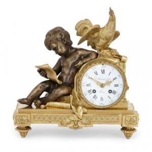 Silvered and gilt bronze antique mantel clock by Beurdeley