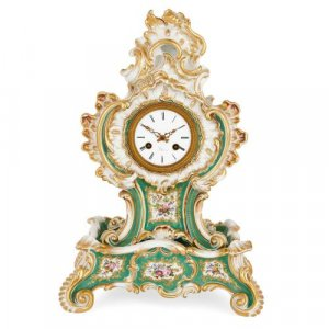Rococo style porcelain mantel clock by Jacob Petit