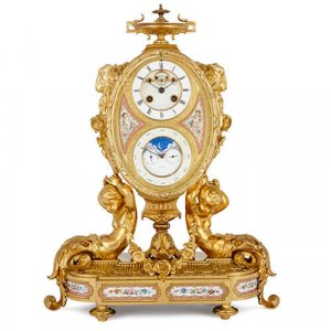 Sevres style porcelain and ormolu mantel calendar clock