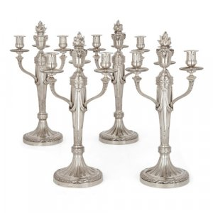 Four French Neoclassical style silver candelabra by Aucoc