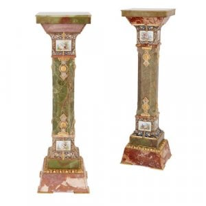 Near pair of onyx and marble pedestals with porcelain plaques