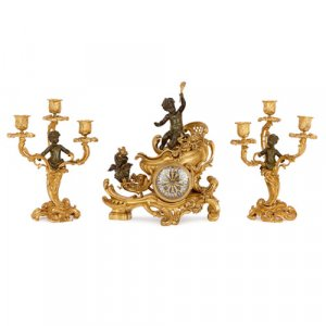 Gilt and patinated bronze clock set, attributed to Linke