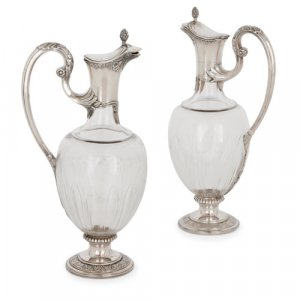 Pair of silver and crystal glass claret jugs by Devaux