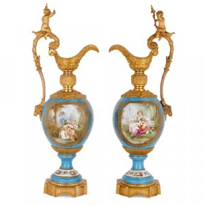 Pair of very large Sèvres style porcelain and ormolu ewers