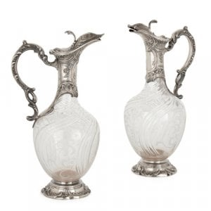 Pair of silver and crystal claret jugs by Charles Hack